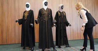 Muslimische Kleidung und Bernstein mit Inklusen